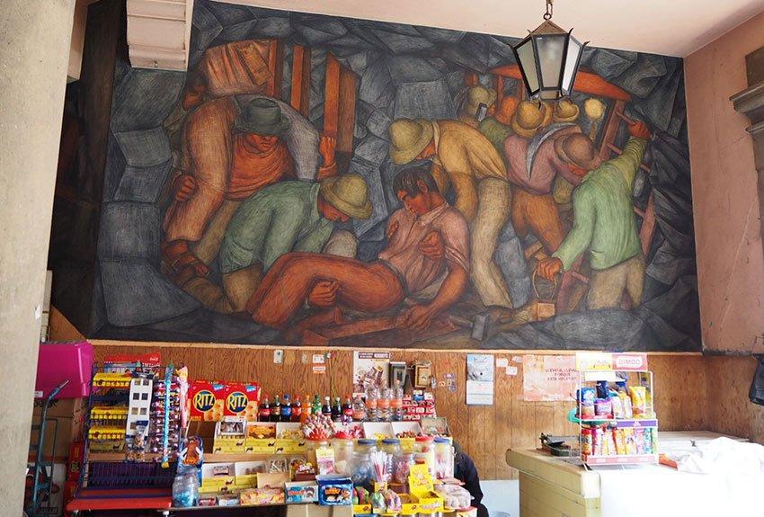 """""""La minería"""" by Grace Greenwood, 1935, at the market entrance at Calle Rodríguez Puebla and Callejón Girón."""