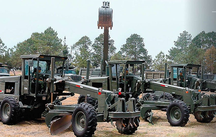 The military's heavy equipment is ready to build the airport, but the permits aren't approved yet.