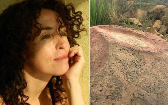 Artist Mercedes Aquí and the petroglyph.