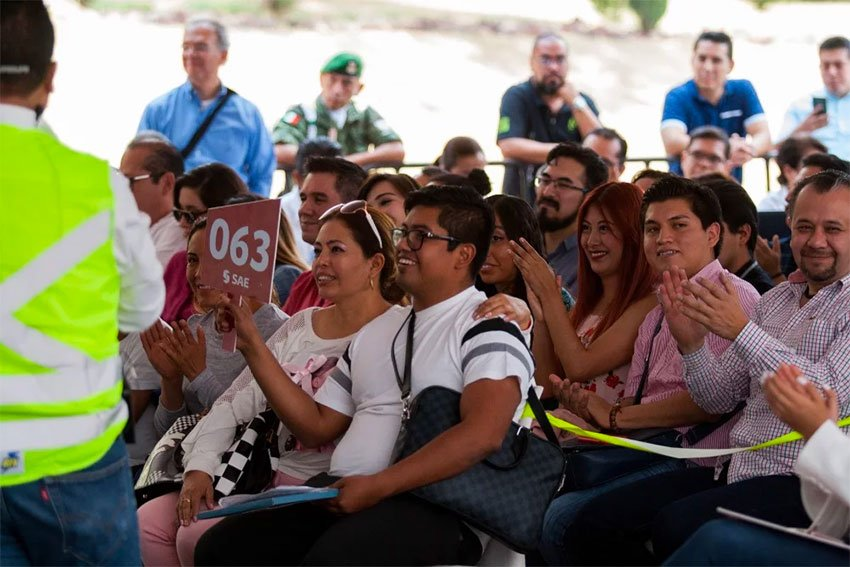 Prospective buyers at Sunday's narco-auction.