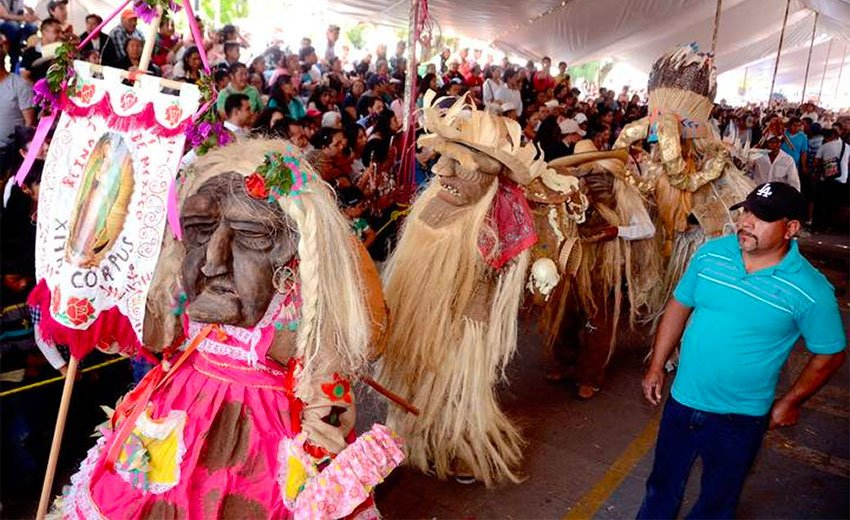 Residents dance wearing masks to represent the ancestors.