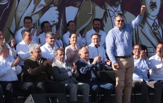 Ebrard, standing, was man of the moment Saturday in Tijuana.