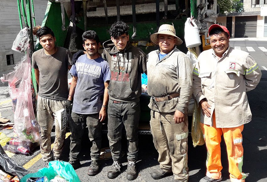 A Mexico City garbage truck crew.