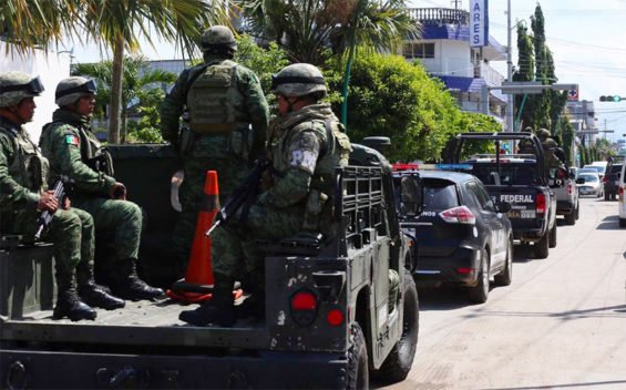 The first mobilization of the National Guard appears in Chiapas, though dressed in police and military uniforms.