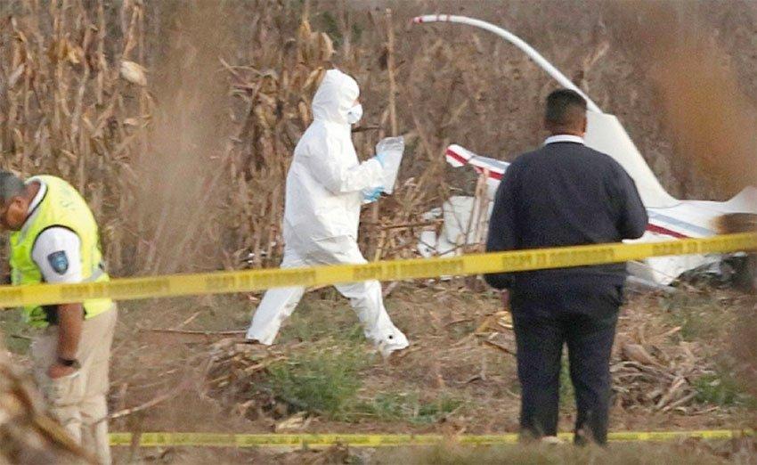 Investigators at the helicopter crash scene.