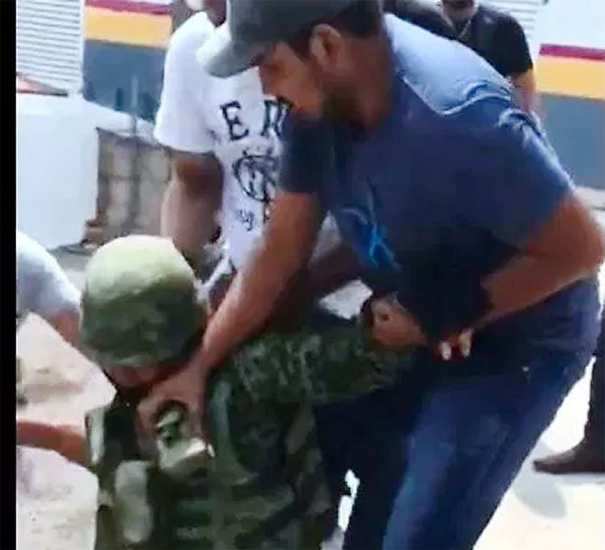 Suspected cartel operator Arzate subdues a soldier in La Huacana.