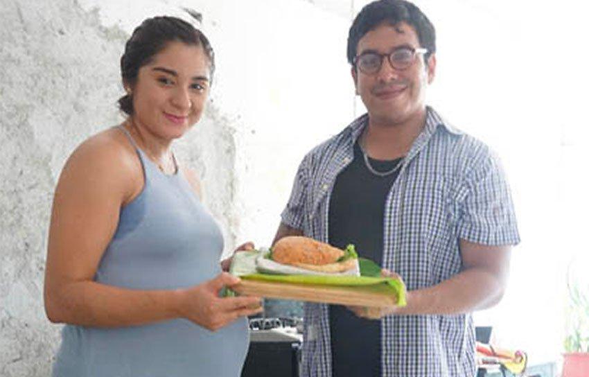 Oaxaca entrepreneurs and their environmentally friendly burger packaging.