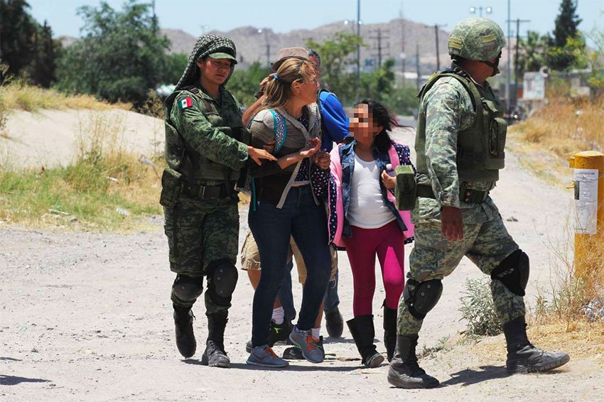 Soldiers detain migrants at northern border Friday but president says they have no orders to do so.