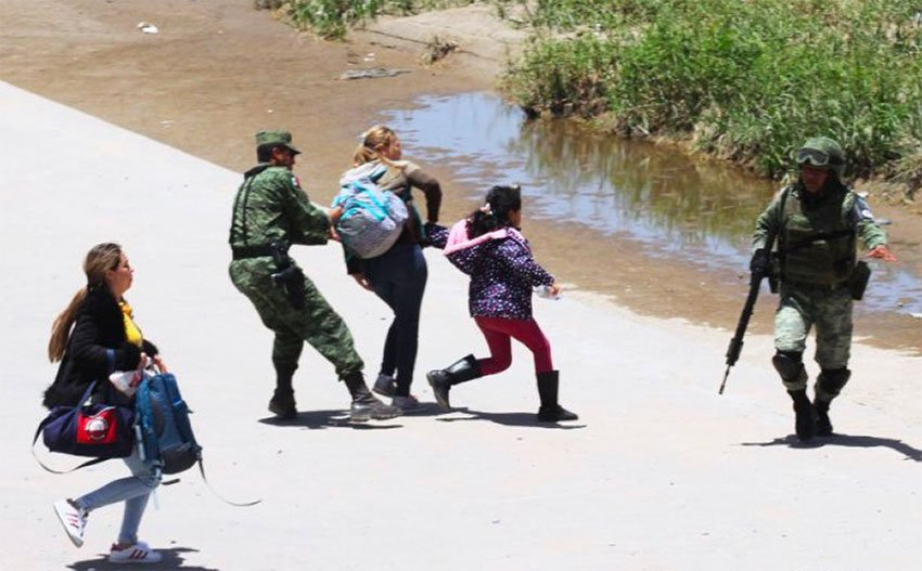 Soldiers nab migrants attempting to cross the northern border into the US.