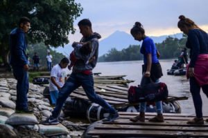 Migrants enter Mexico from Guatemala.
