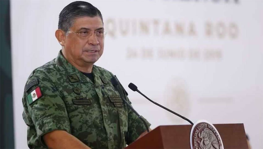 Defense Secretary Sandoval said forces are detaining migrants, but president says they have no orders to do so.