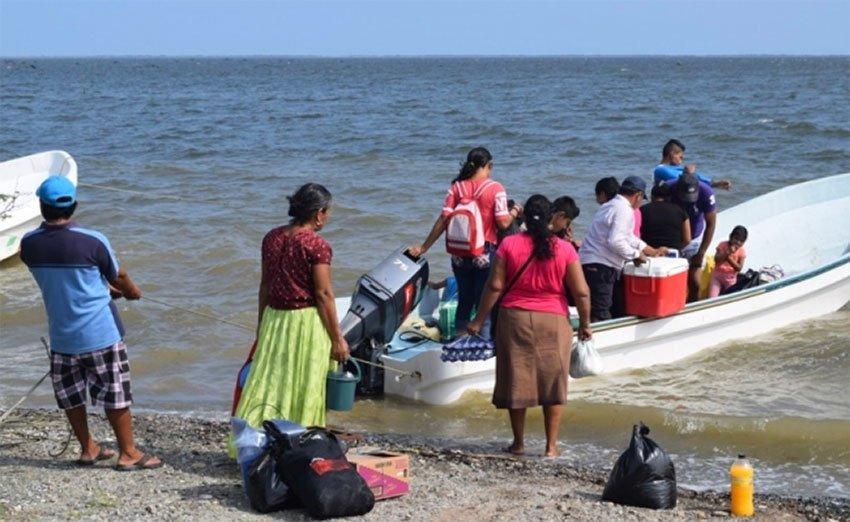 Santa María residents board a boat to reach their homes.