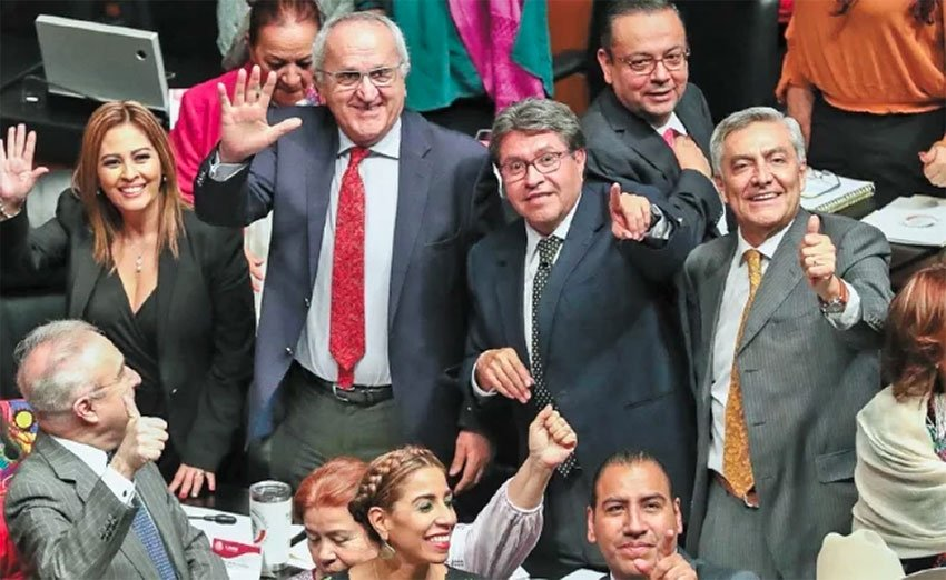 Senators and Jesús Seade, second from left, celebrate trade deal's approval.