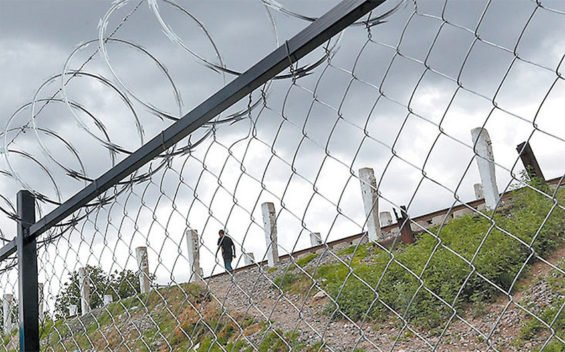 The fence surrounding a migrant shelter in Tlaxcala.