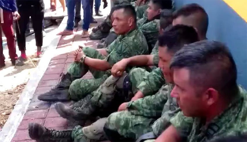 Soldiers who were taken captive by suspected cartel operators.