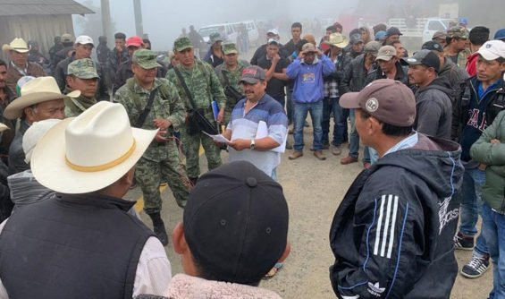 Soldiers and police have been held captive by farmers in Guerrero since Friday.