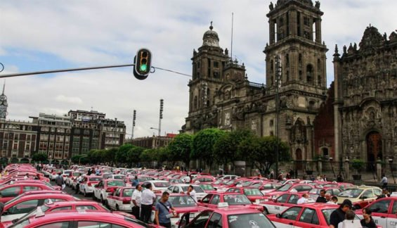 A cluster of taxis in Mexico City on Monday.