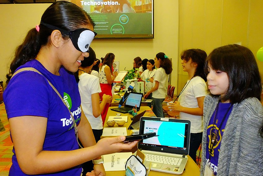 A blindfolded visitor gives Be My Eyes a practical test. The app was developed to help the blind get around.