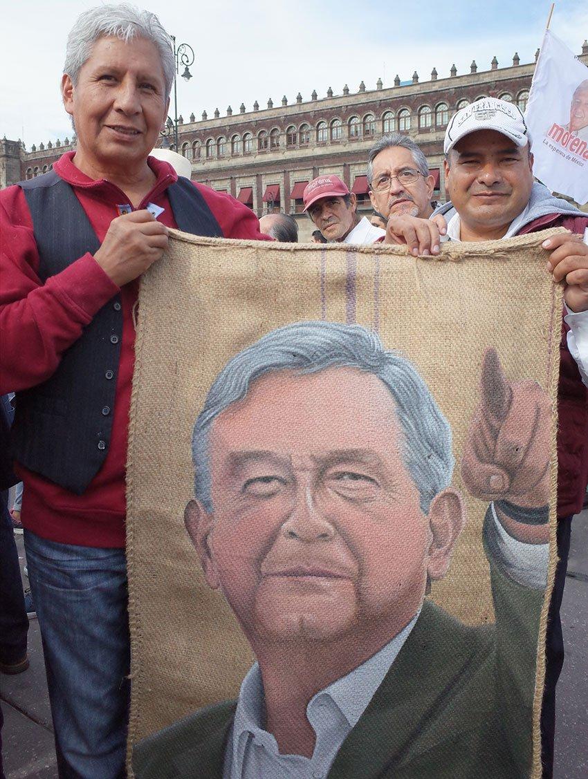 Artist González, left, with his portrait of López Obrador.