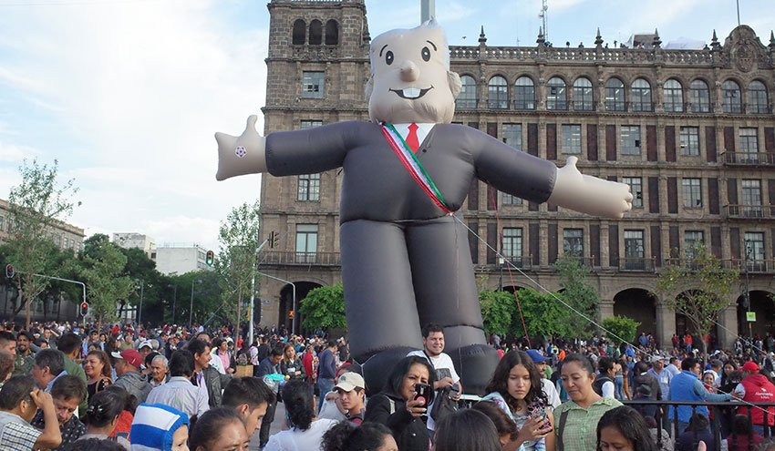 An inflatable AMLO watches over the celebration on Monday.