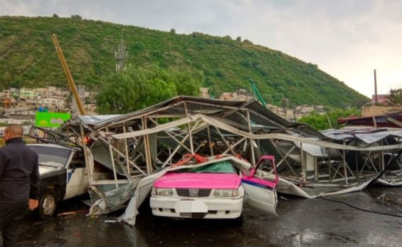 The billboard squashed a taxi when it fell during wind and rain Thursday.