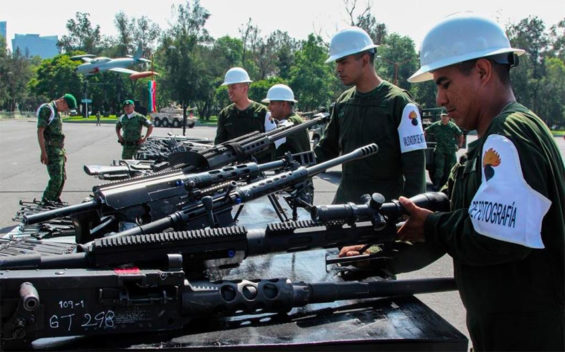 Soldiers destroy seized firearms.