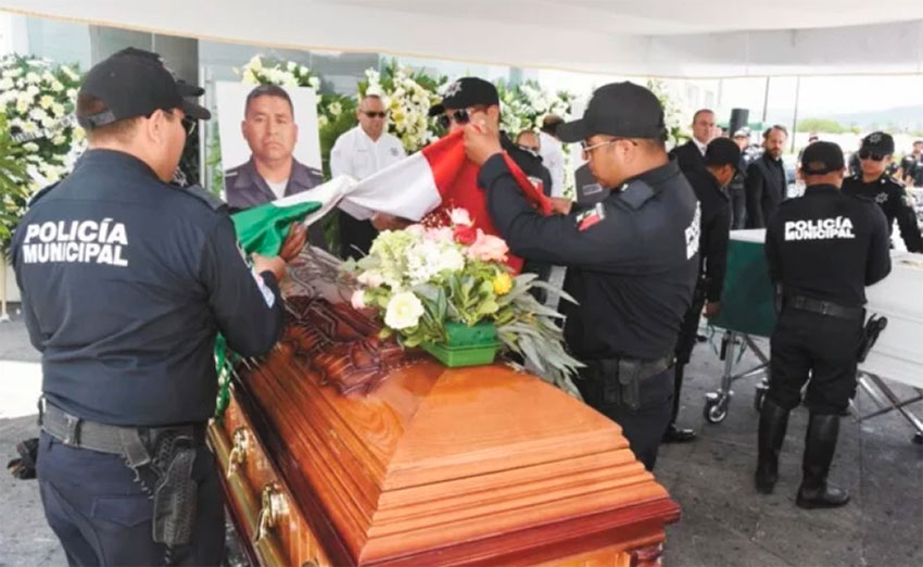 The funeral for the two police officers killed last week in San Miguel.