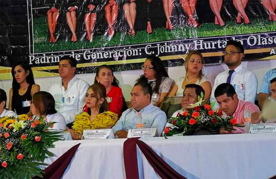 A photo of the class behind the head table announces sponsorship by wanted gang leader.