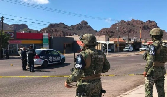 National Guardsmen watch over Guaymas crime scene on Tuesday.