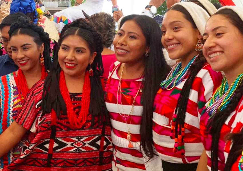 Actress Yalitza Aparicio, center, with Guelaguetza dancers in Oaxaca.