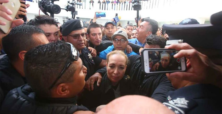 Senior National Guard official Trujillo caught in the crush at Federal Police headquarters.