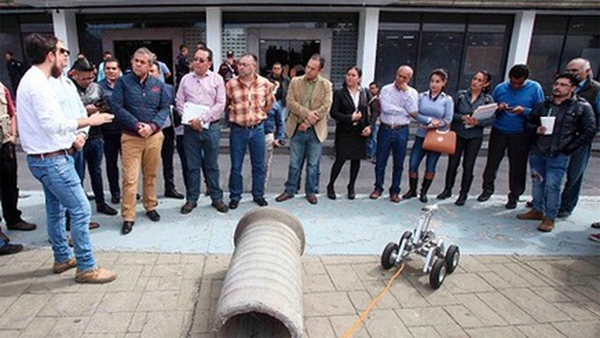 Officials in Ecatepec demonstrate their new robot.