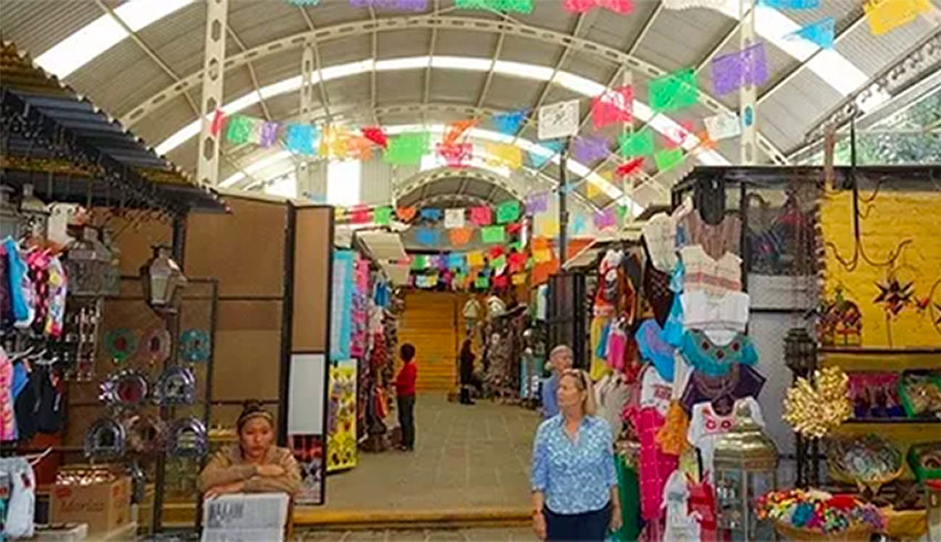 Vendors at the artisans' market are among those forced to pay extortion.