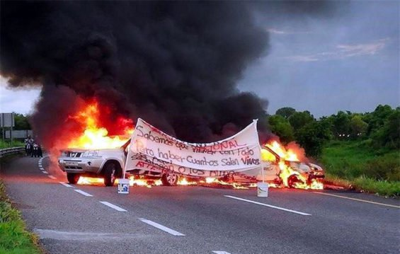 Vehicles burn in Tabasco this morning in warning to National Guard.