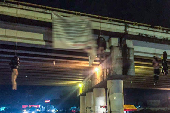 Bodies hang from an overpass this morning with a narco-banner signed by the Jalisco New Generation Cartel.
