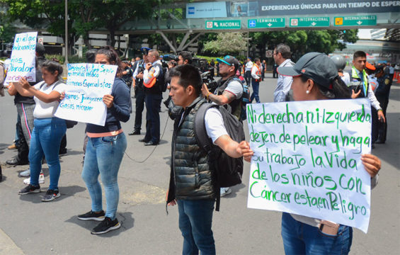 Protesting parents block traffic on Monday at Mexico City airport.