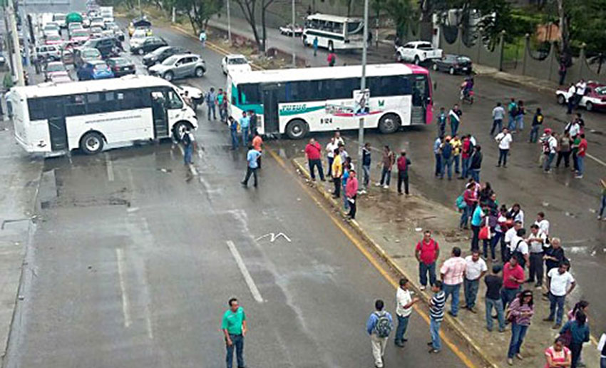 Teachers block a highway with hijacked buses in a 2015 protest.