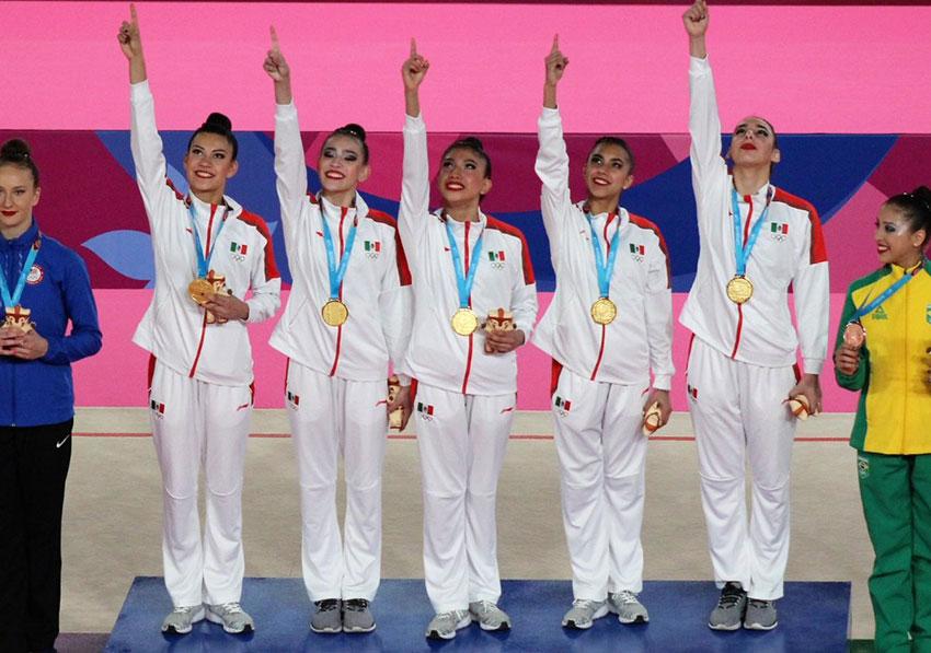 The women's rhythmic gymnastics team with their second gold medal.