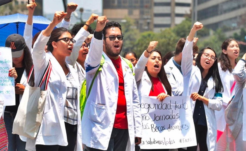 Interns march in Mexico City today.