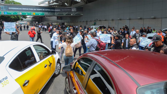 Protesters at Mexico City airport on Monday.Protesters at Mexico City airport on Monday. lack of cancer medications for their children.