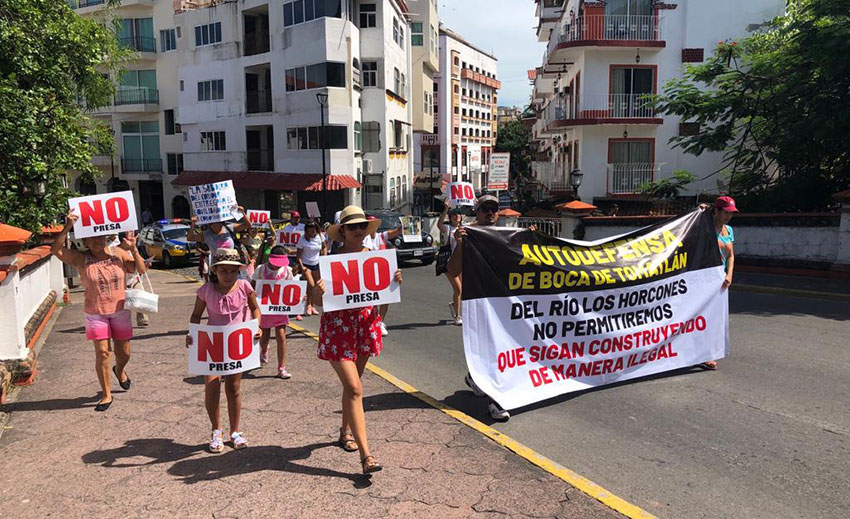 People protest the Horcones dam at a march in downtown Puerto Vallarta on August 25.