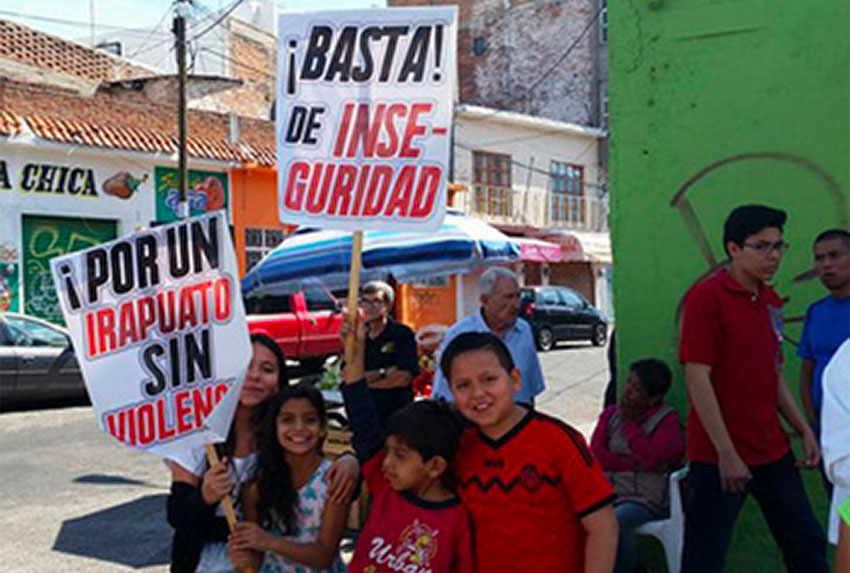 'Enough insecurity,' reads one of the signs at a protest in Irapuato.