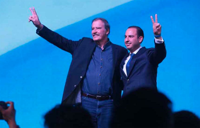 Fox, left, and Cortés at the National Action Party assembly.