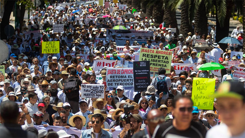 More than 1,000 people marched in Mexico City to demonstrate opposition to the president's administration.