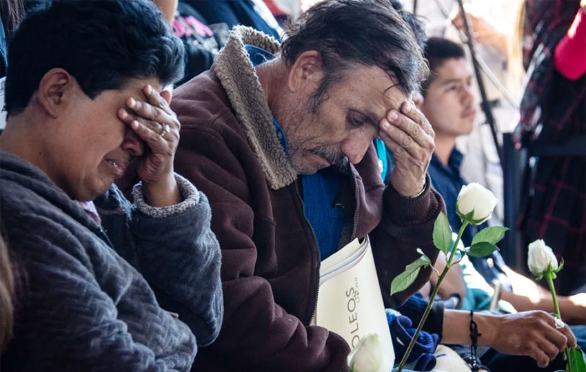 Relatives grieve at the memorial for slain Michoacán police officers.