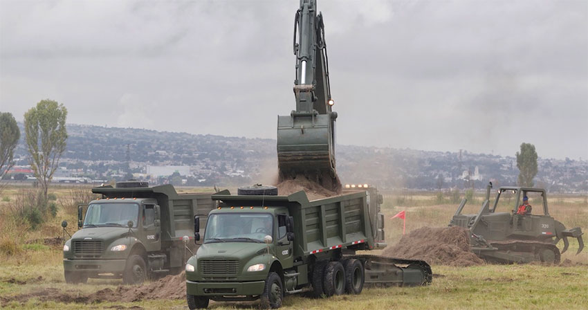 Military equipment at work on new airport site.
