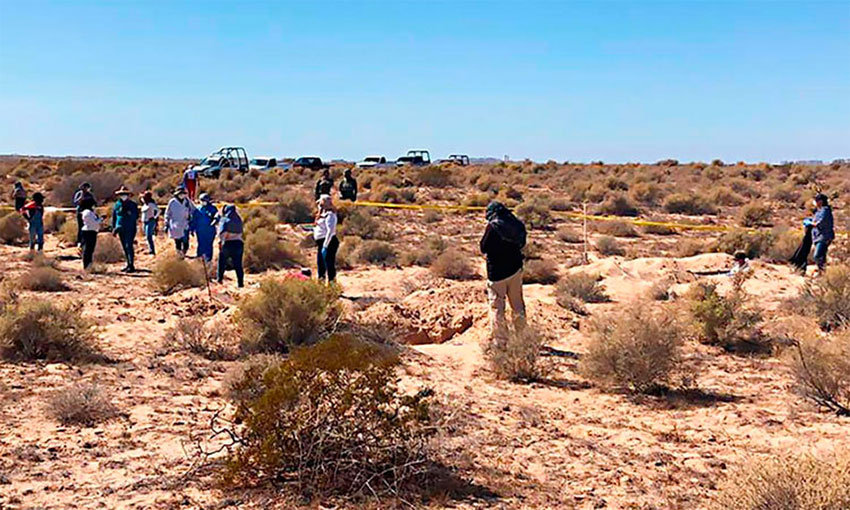 Searchers at the site where the bodies were found.