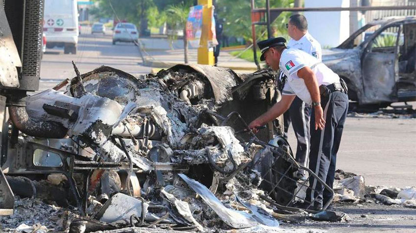 The wreckage of a burned-out vehicle after the violence in Culiacán.