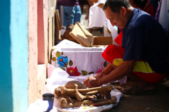 Cleaning up the family bones in Pomuch, Campeche.
