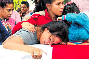 The widow of one of the slain officers at his funeral on Wednesday in Michoacán.
